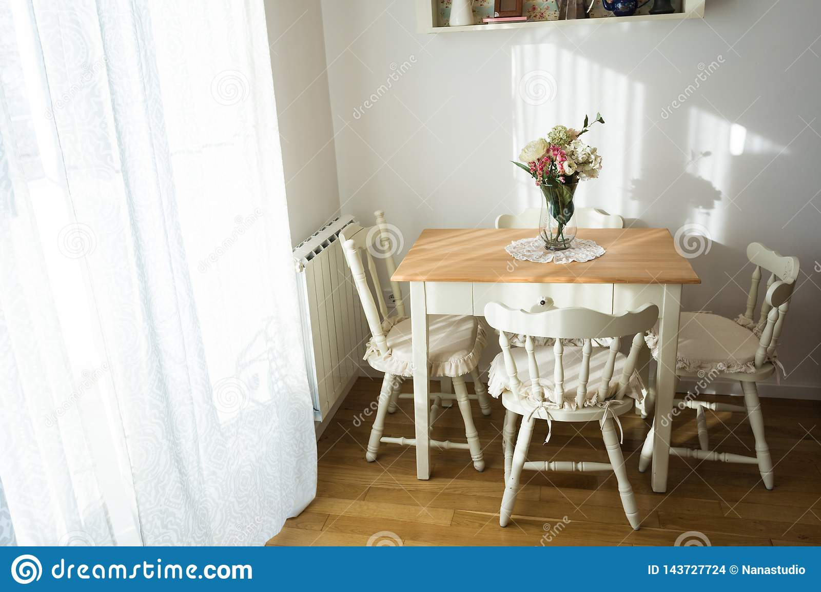 Nicely decorated living  lunch  room. Dining table and some chairs