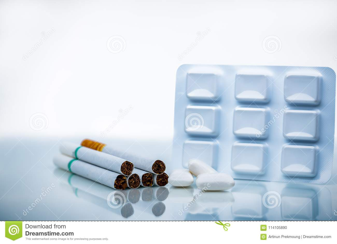 Nicotine Chewing Gum In Blister Pack Near Pile Of Cigarette