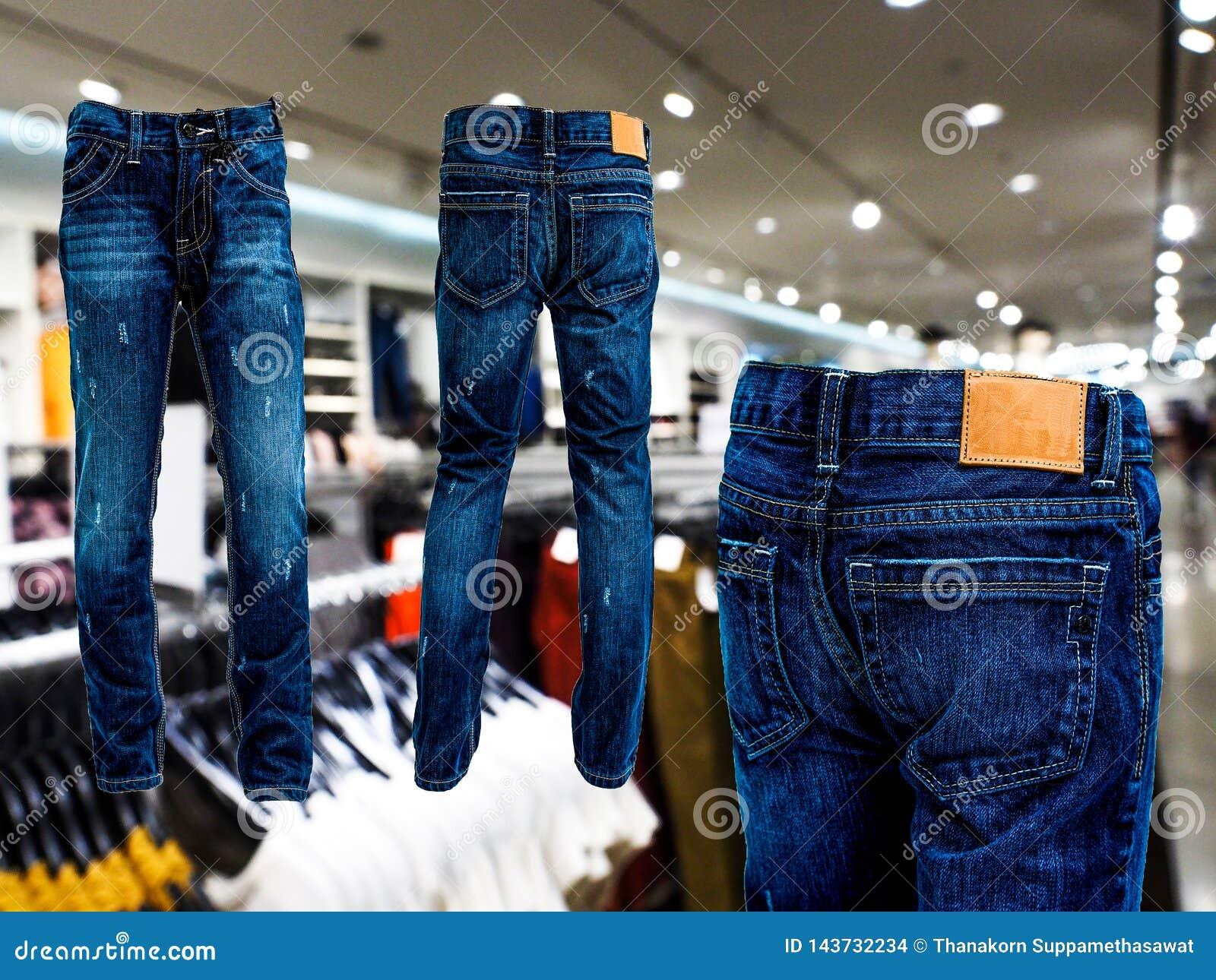 Niebiescy dżinsy spodnie odizolowywający tyły i przód W sklepie