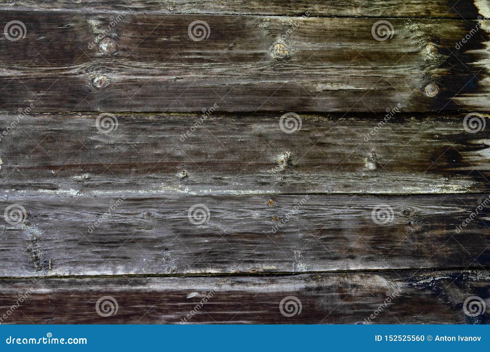 Nieociosany ciemny drewno deski tło lub tekstura
