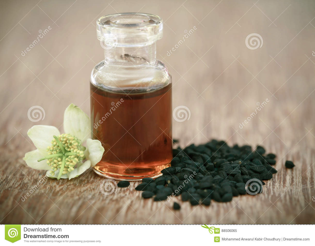 Nigella flower with seeds and essential oil