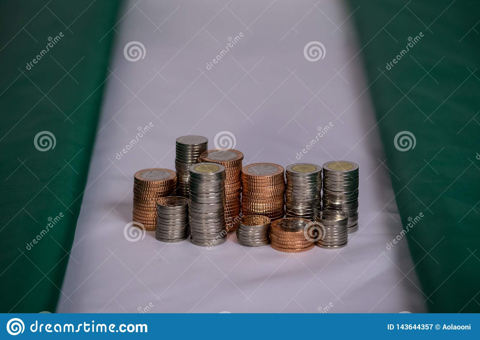 Nigeria flag with coins in a stack