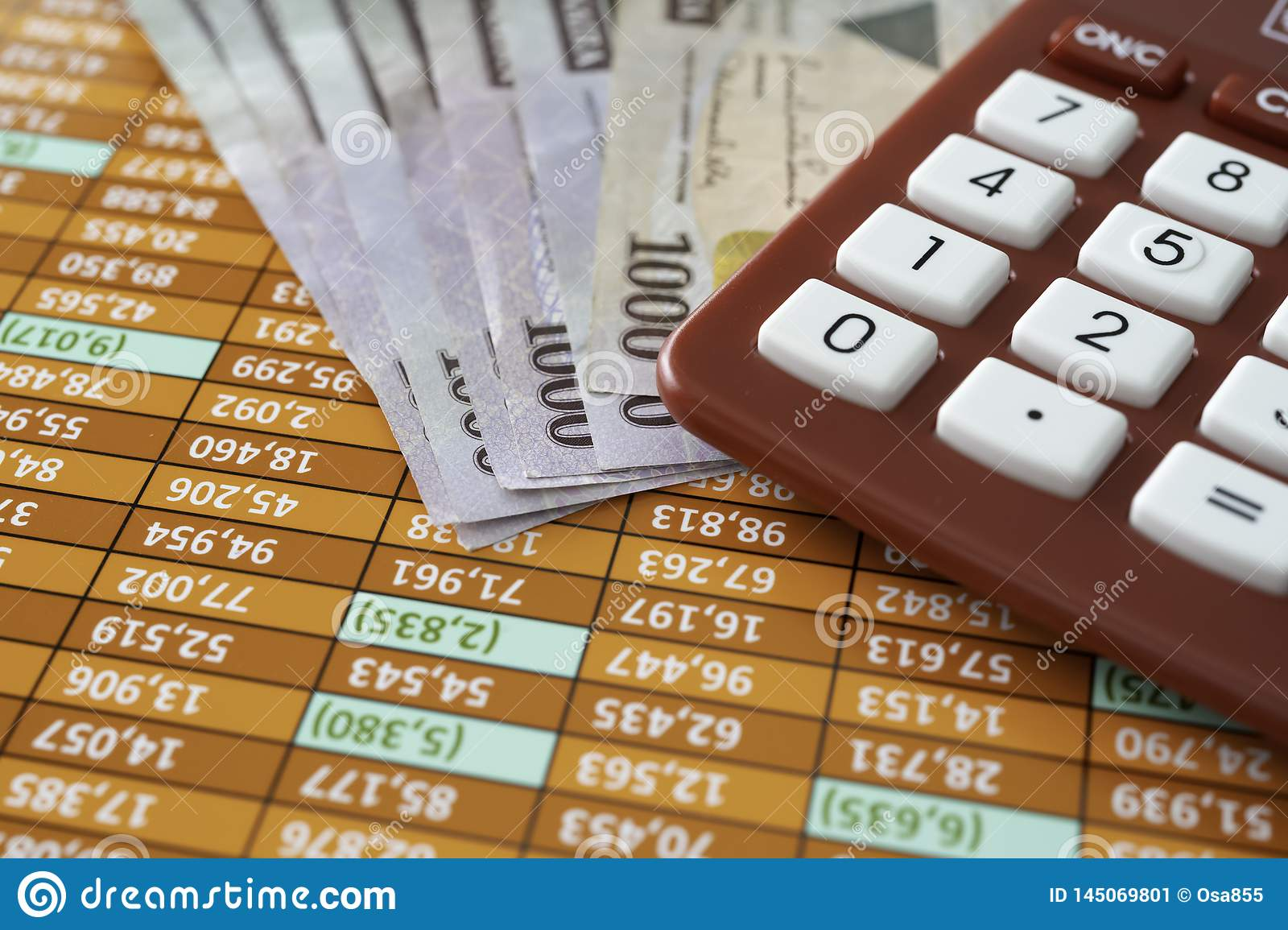 Nigerian Naira Notes with Calculator on Spreadsheet