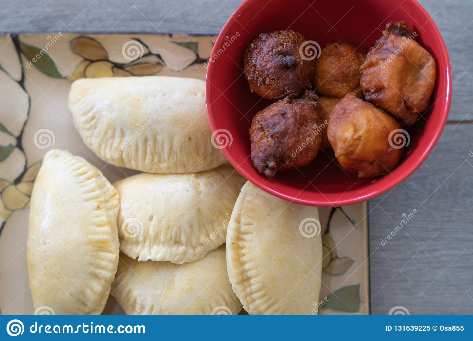 Nigerian Puff Puff And Meatpie Snacks Served With Iced Tea