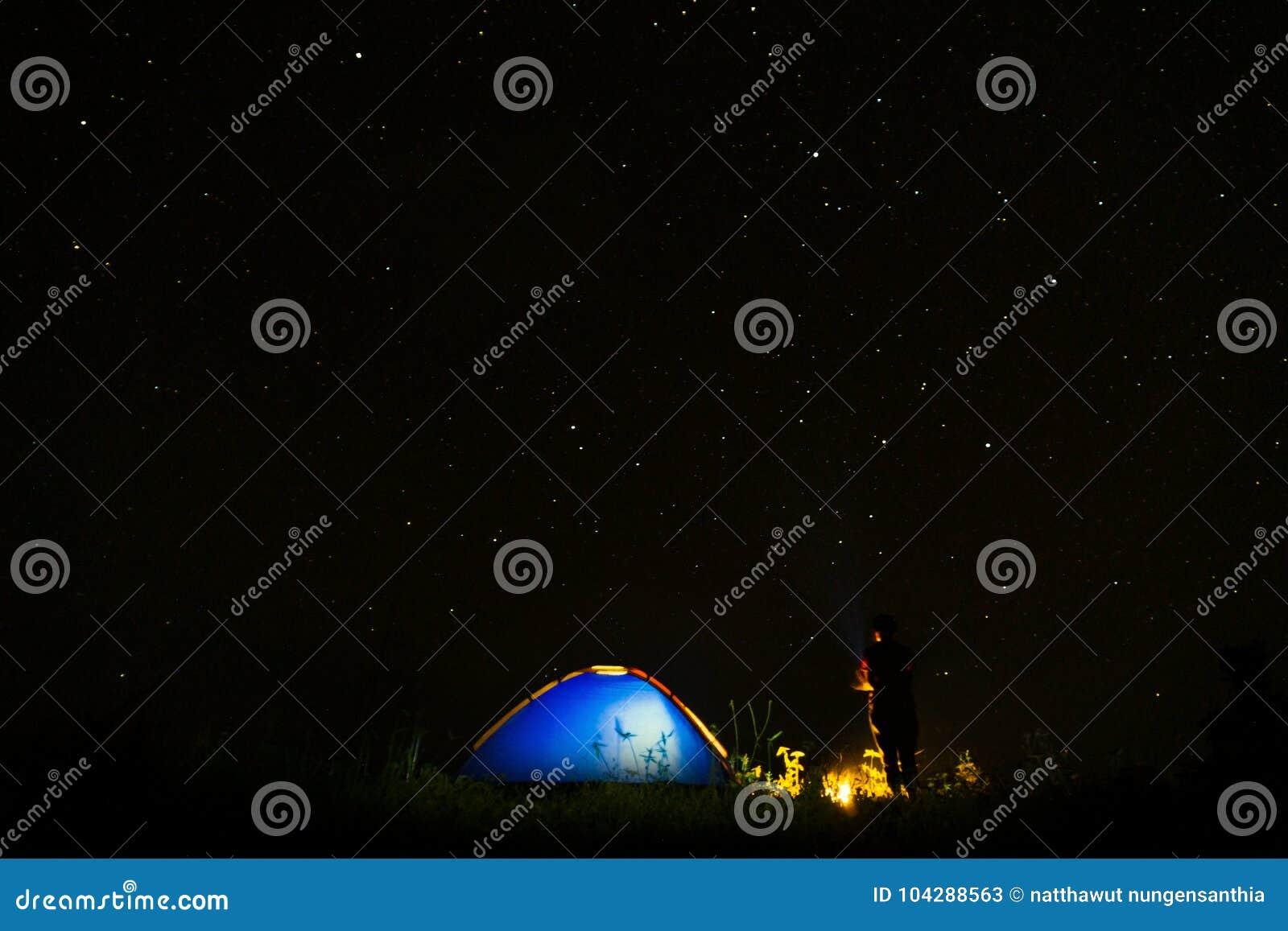 Night Camping. Campfire Near Illuminated Tent Under ...