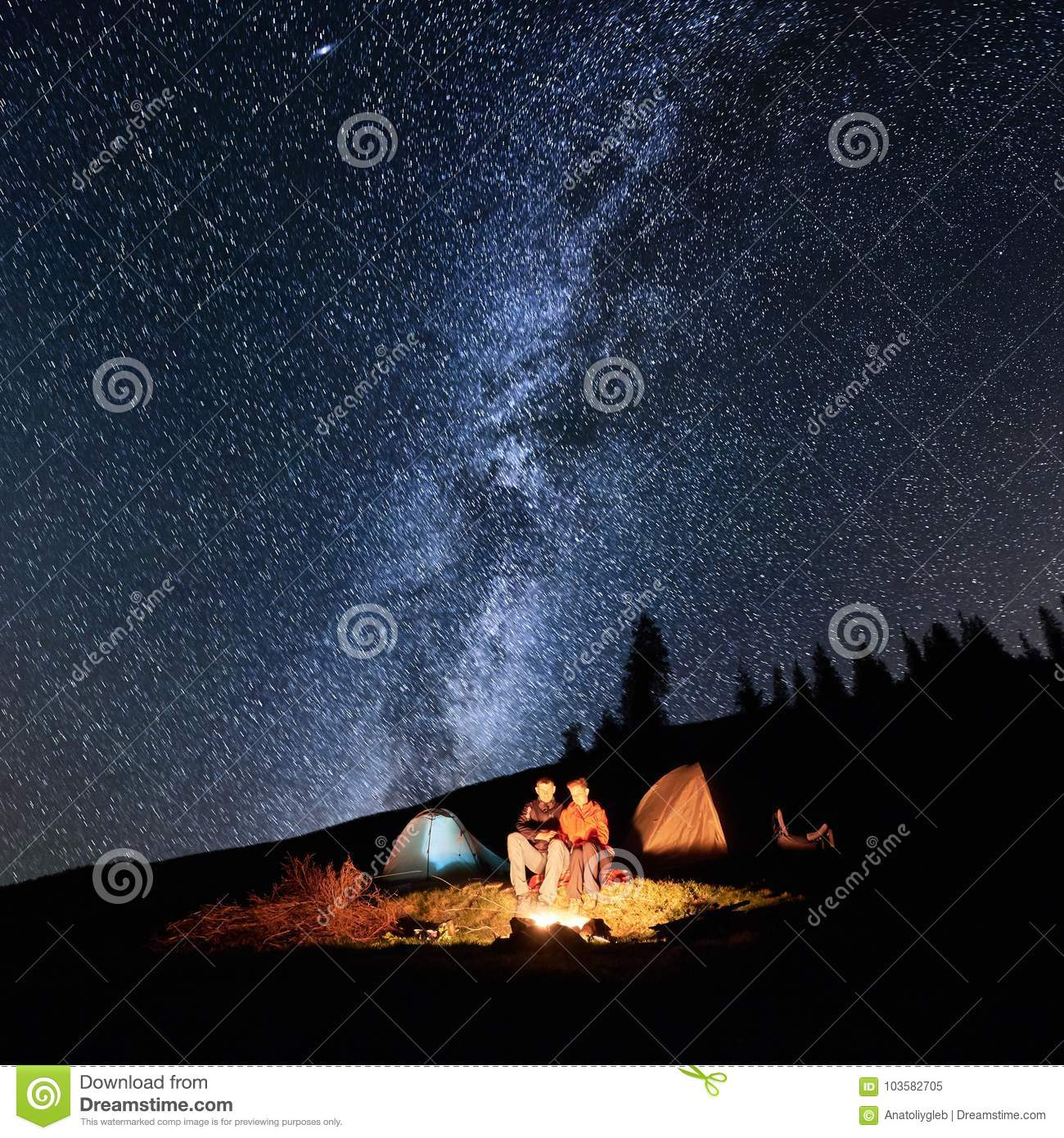 Couple Tourists Near Campfire And Tents Under Night Sky Full Of Stars And Milky Way Stock Image Image Of Starry Hike 103582705