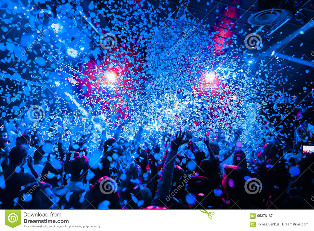 Night club silhouette crowd hands up at confetti steam stage