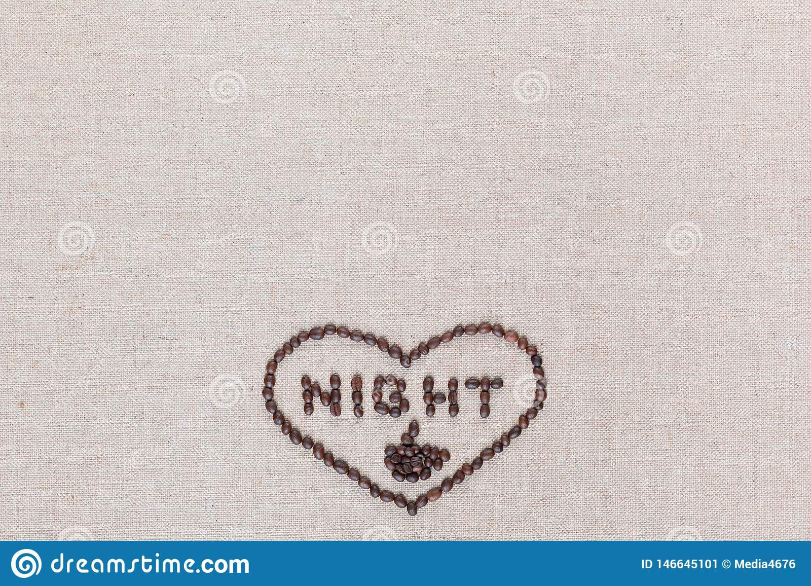 Night in heart sign from coffee beans isolated on linea texture, aligned bottom center