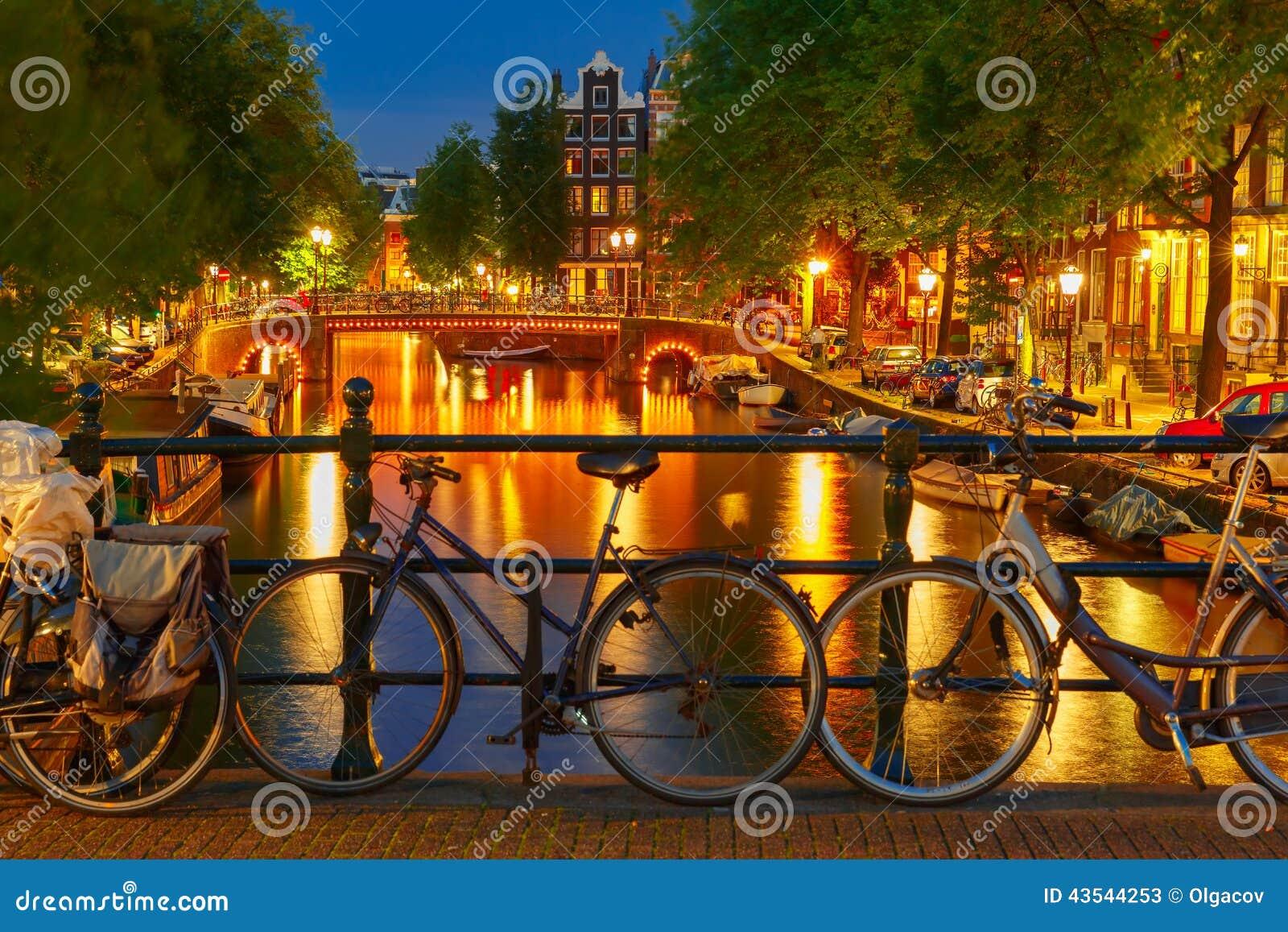 Night illumination of Amsterdam canal and bridge
