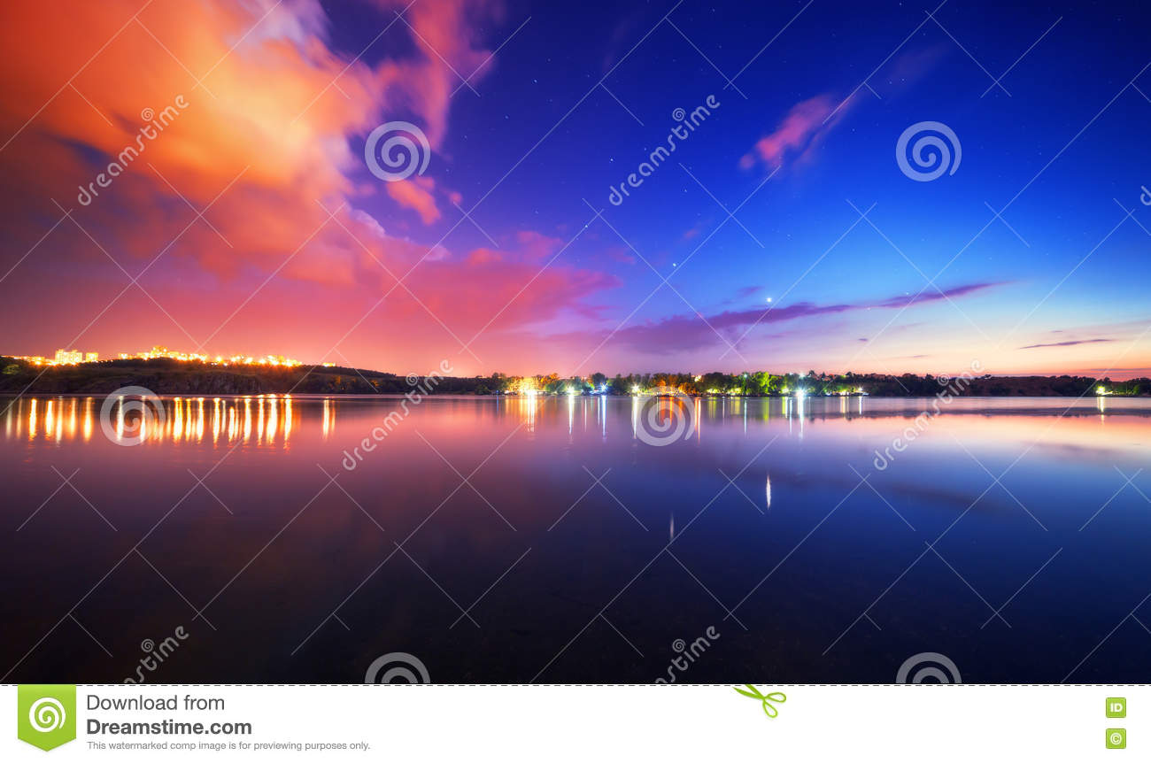 Night landscape on the lake with blue sky and clouds