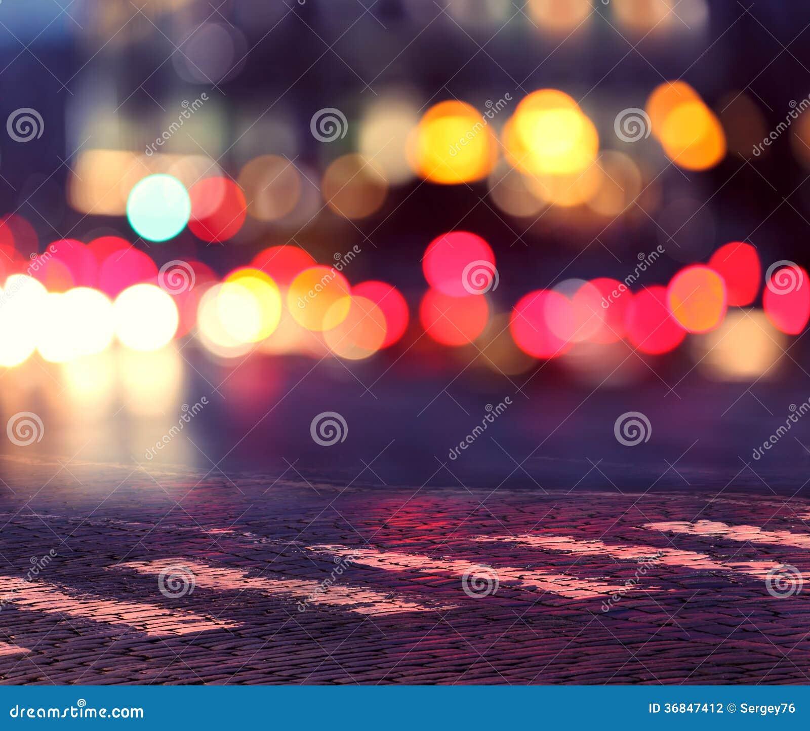 Night lights in city and zebra crossing