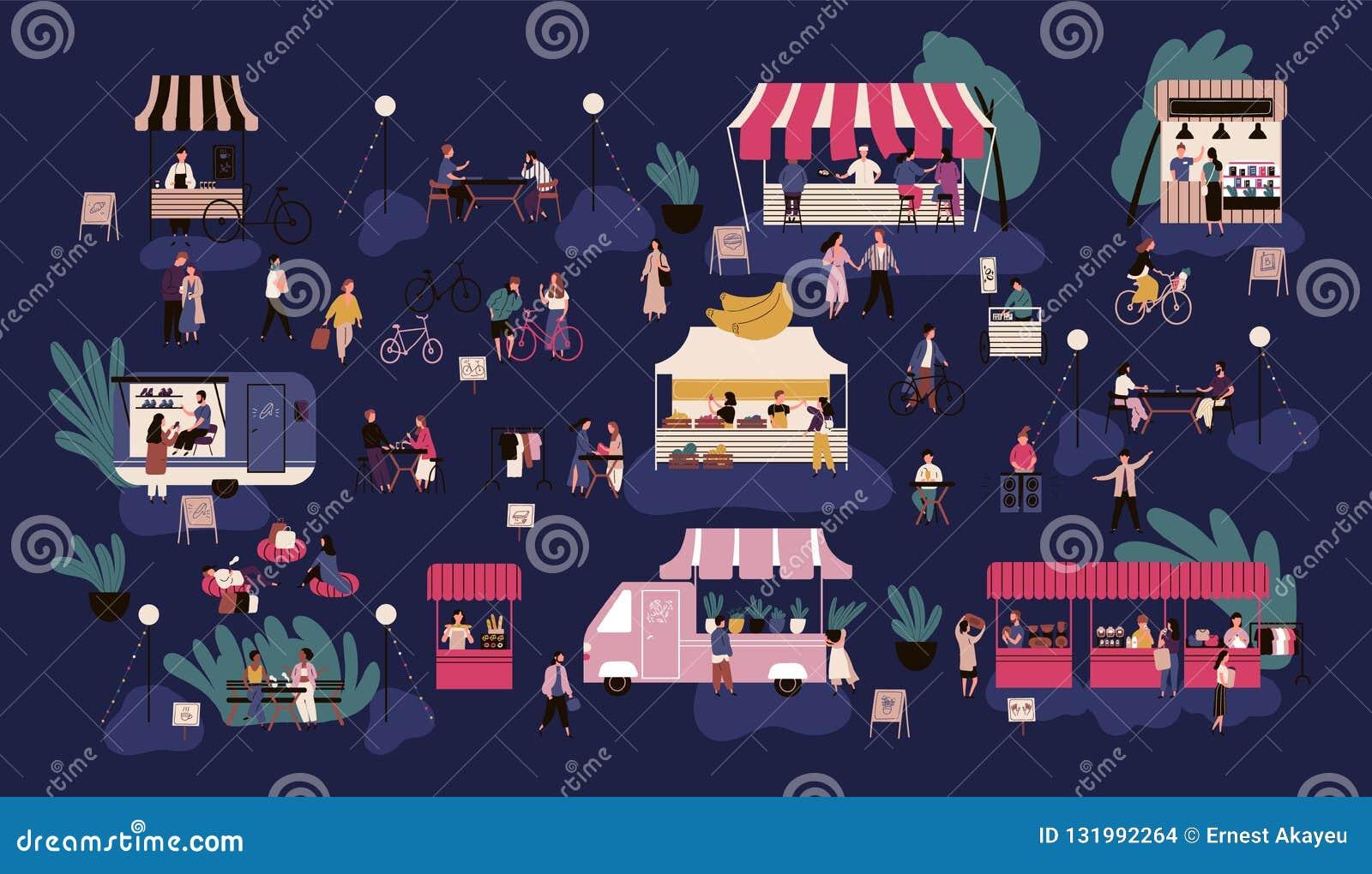 Night market or nighttime outdoor fair. Men and women walking between stalls or kiosks, buying goods, eating street food