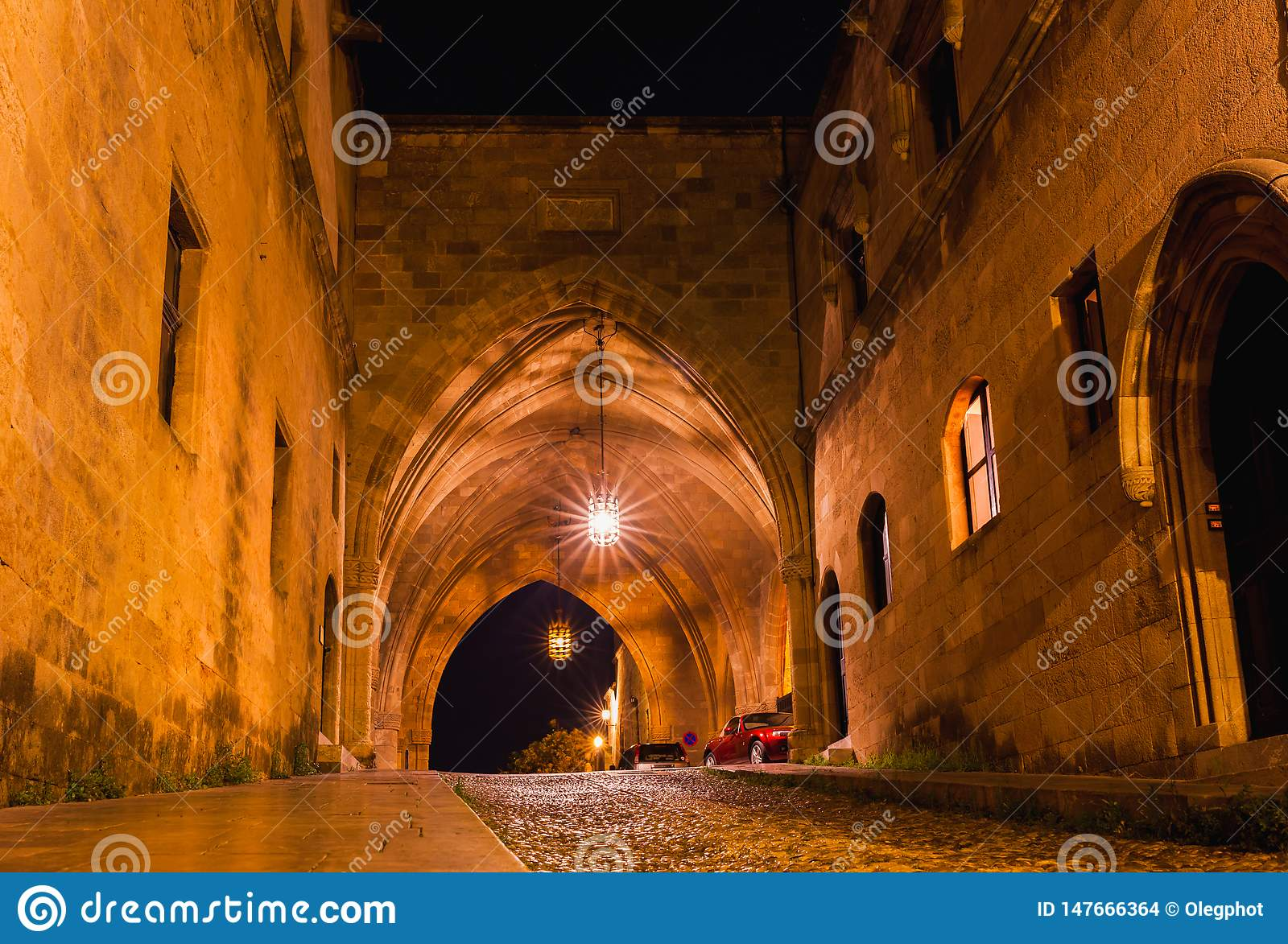 Night photo of ancient street of the Knights in Rhodes city on Rhodes island, Dodecanese, Greece. Stone walls and bright night