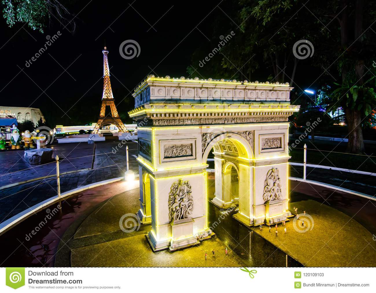 Night photography of The Arc de triomphe Paris at miniature park is an open space that displays miniature buildings and models.