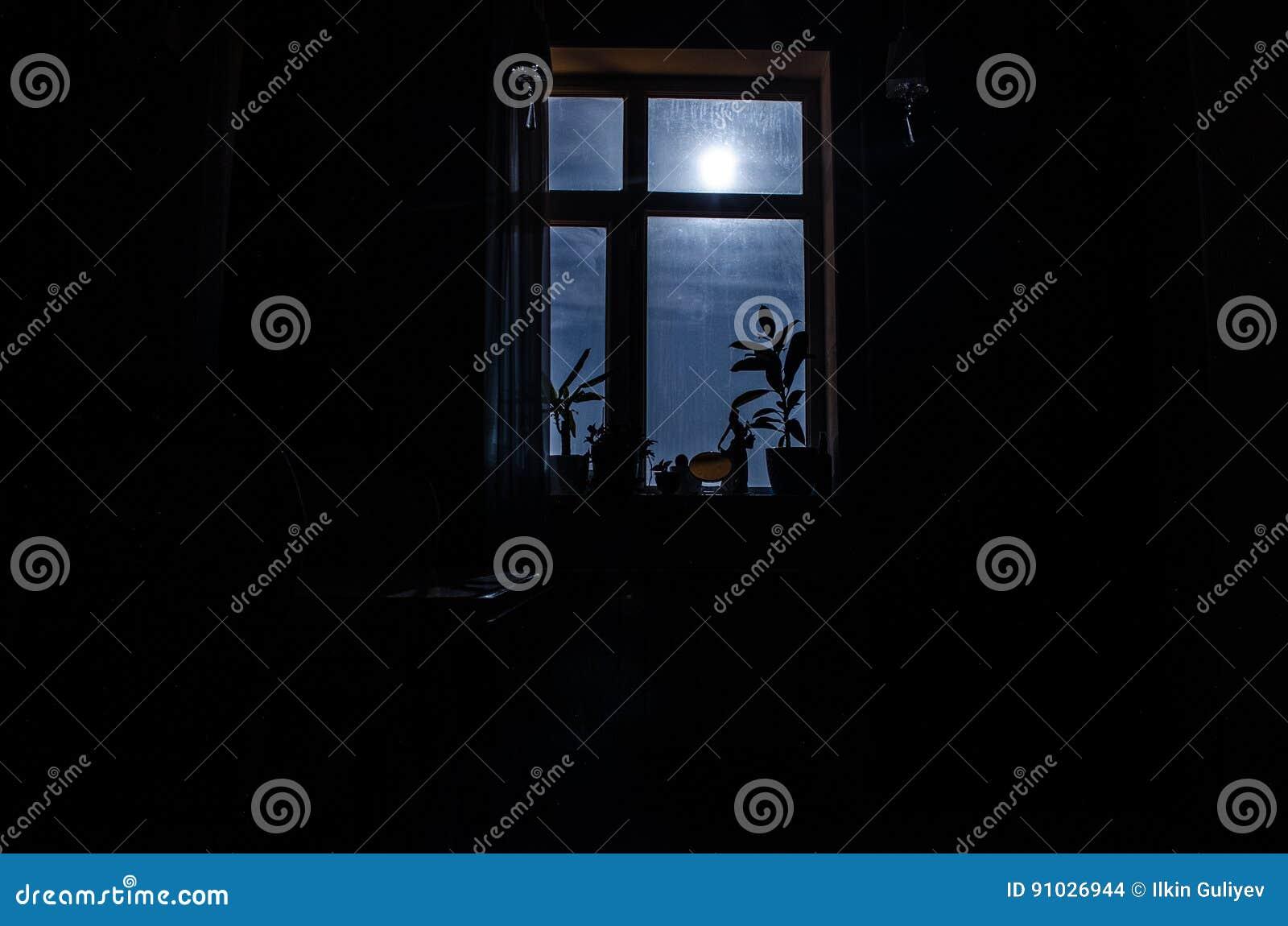 Window at night from inside - Night Scene Of Moon Seen Through The Window From Dark Room Stock Photo