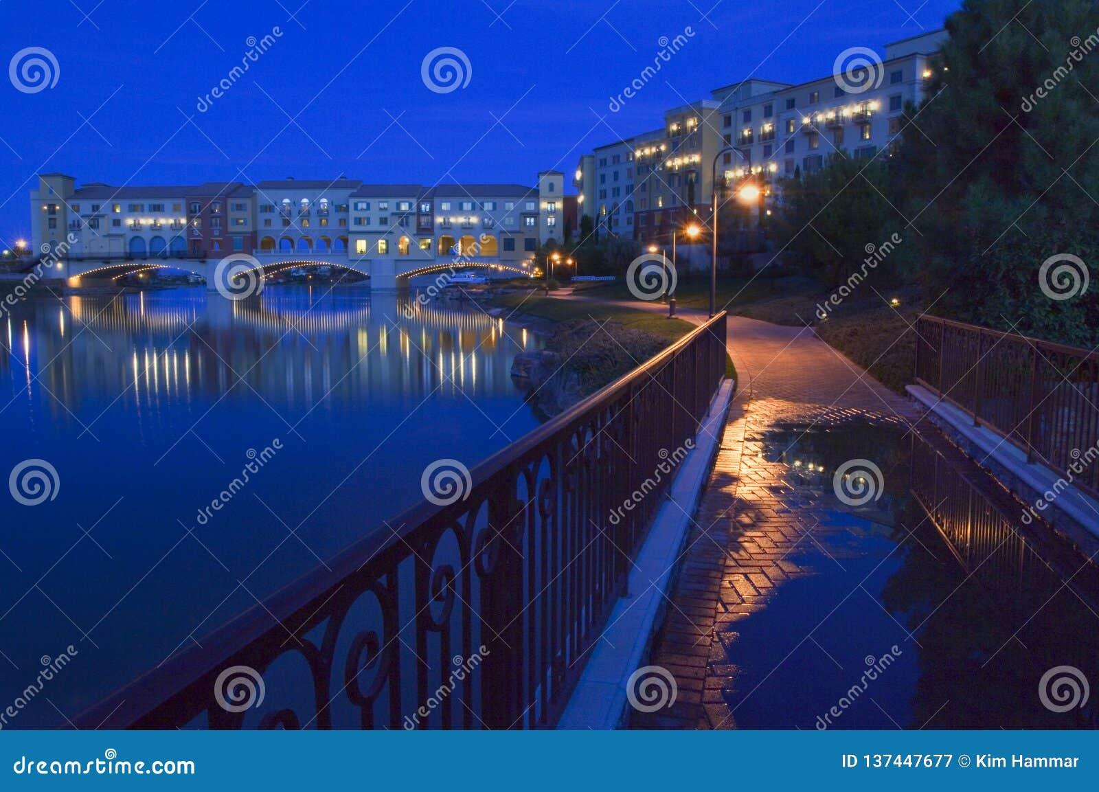 Night settles around the Pontiveccio Bridge over Lake Las Vegas in Nevada.