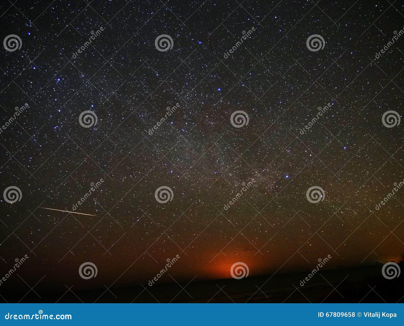 Night sky stars and iridium flare