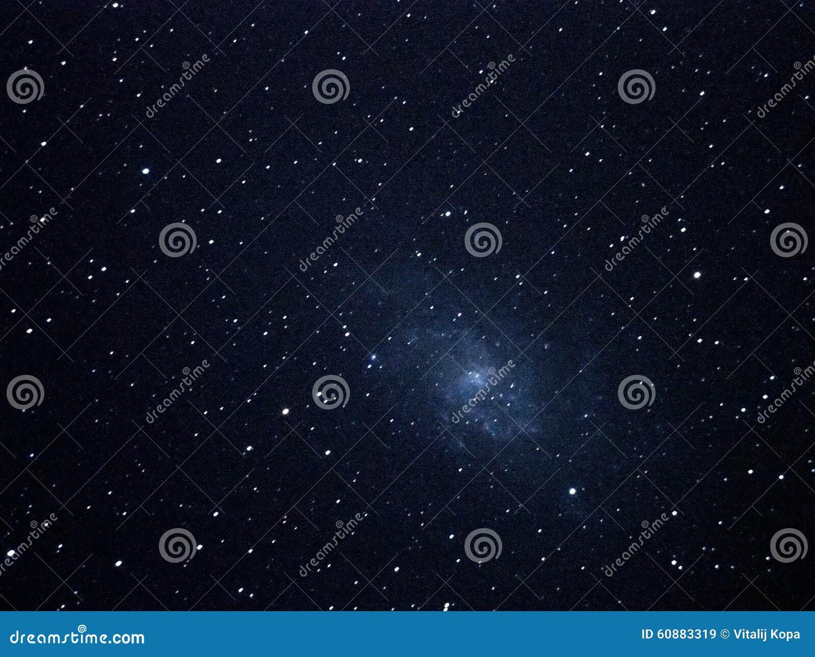 Night sky stars and spiral galaxy M33 over telescope
