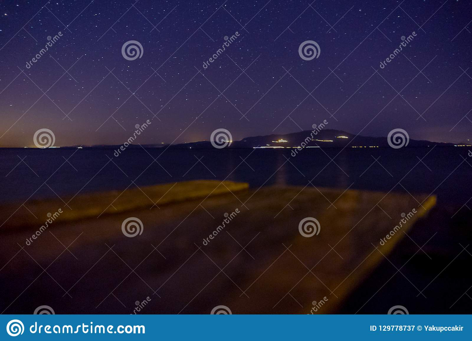 Night sky with stars, view of mykonos from assos
