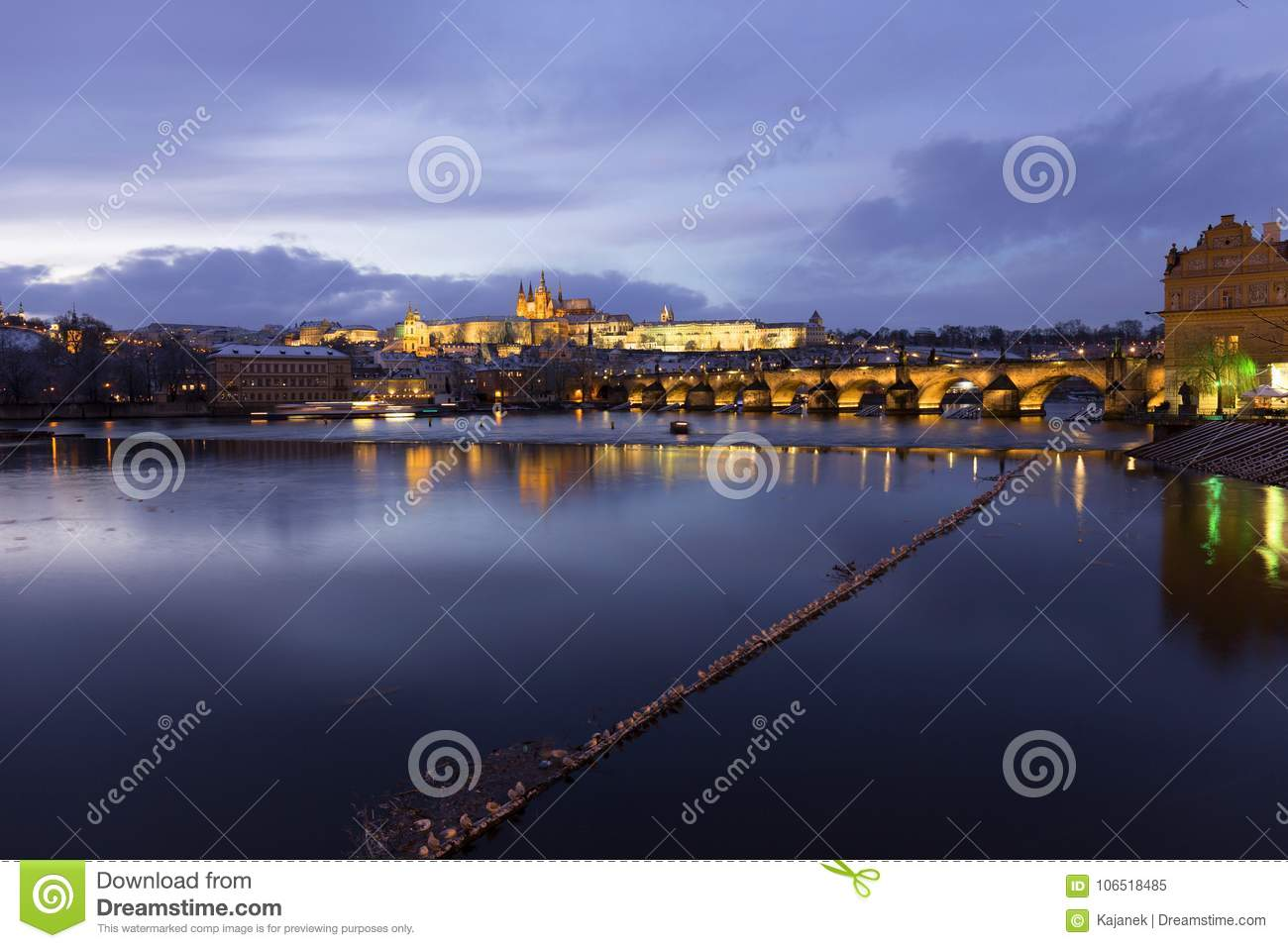 Download Night Romantic Snowy Prague Gothic Castle And St Nicholas Cathedral With Charles Bridge