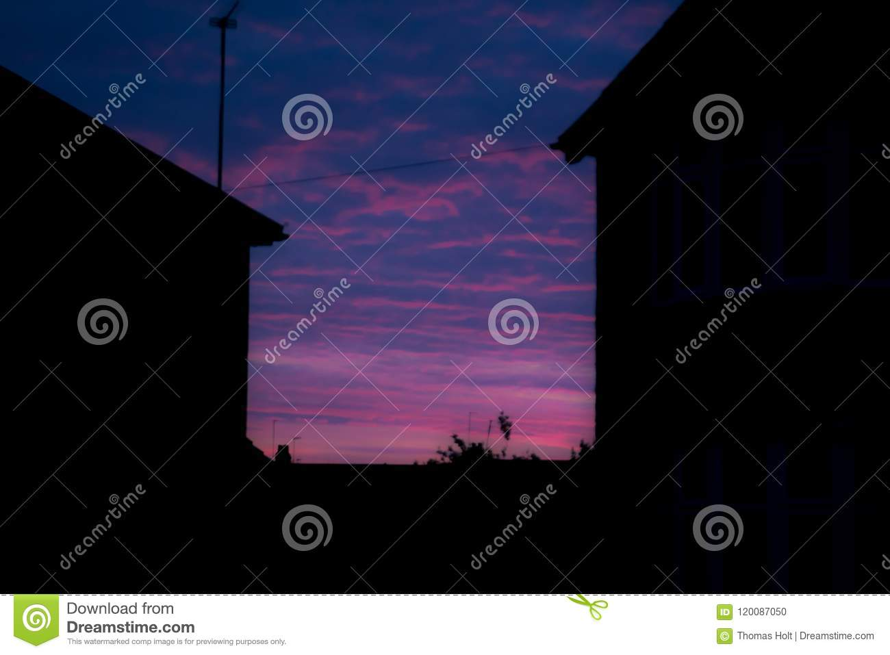 Night time view of house exterior of terraced houses on a street