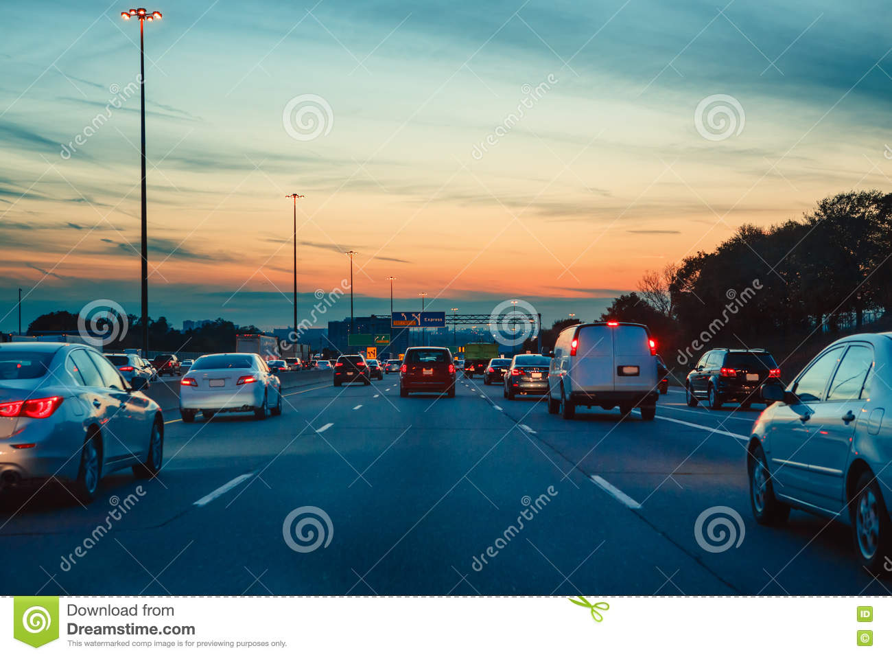 Cars Driving By A Busy Street