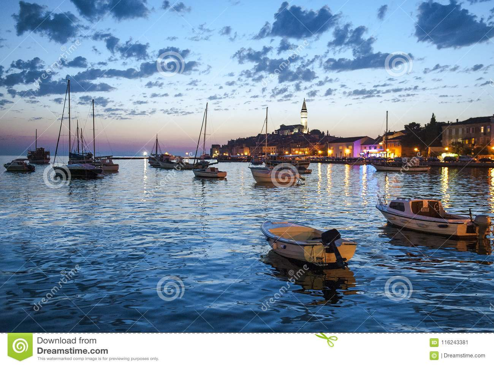 Night view of beautiful town Rovinj in Istria, Croatia. Evening in old Croatian city, night scene with water reflections