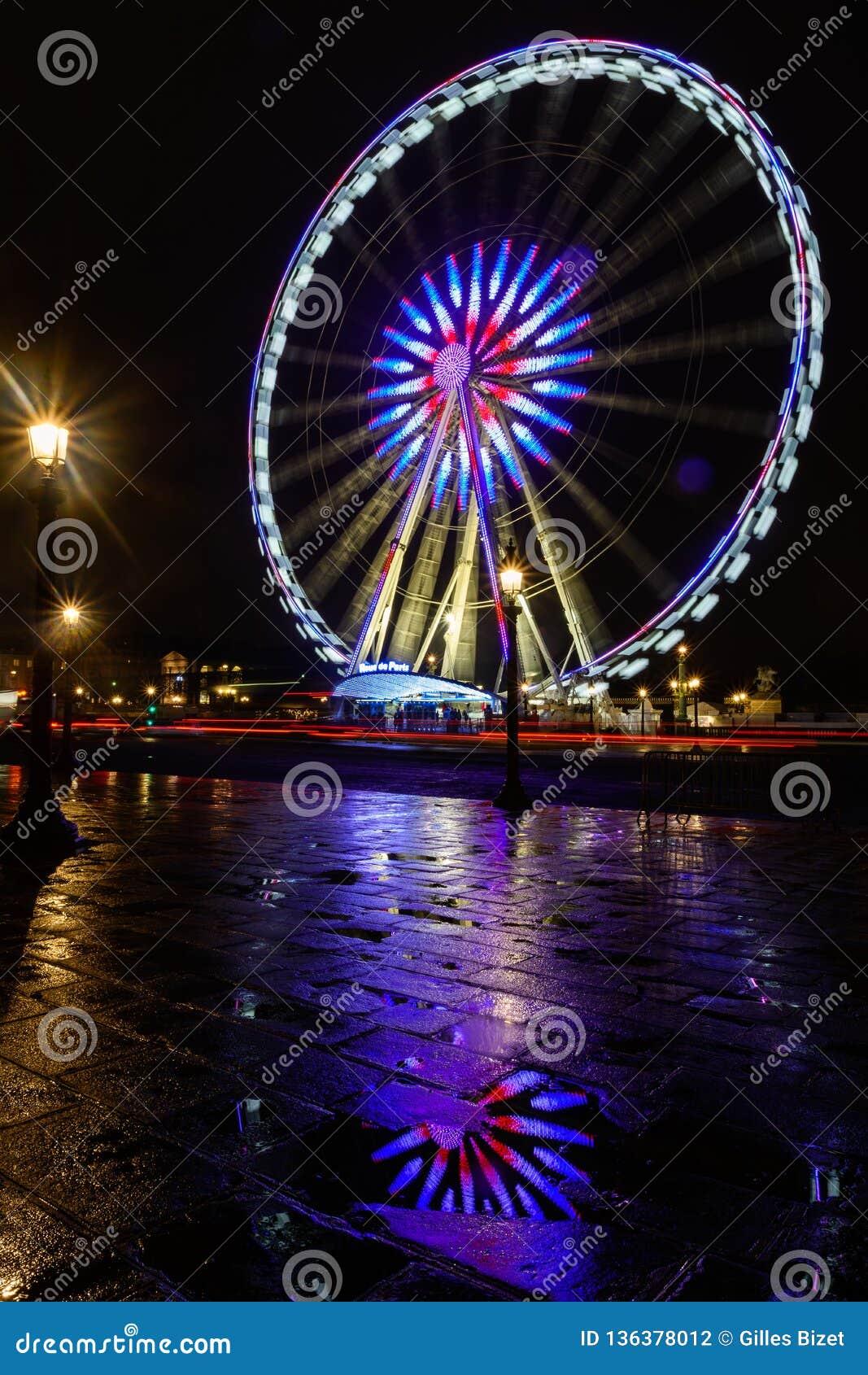 Night view of illuminated big wheel in Paris