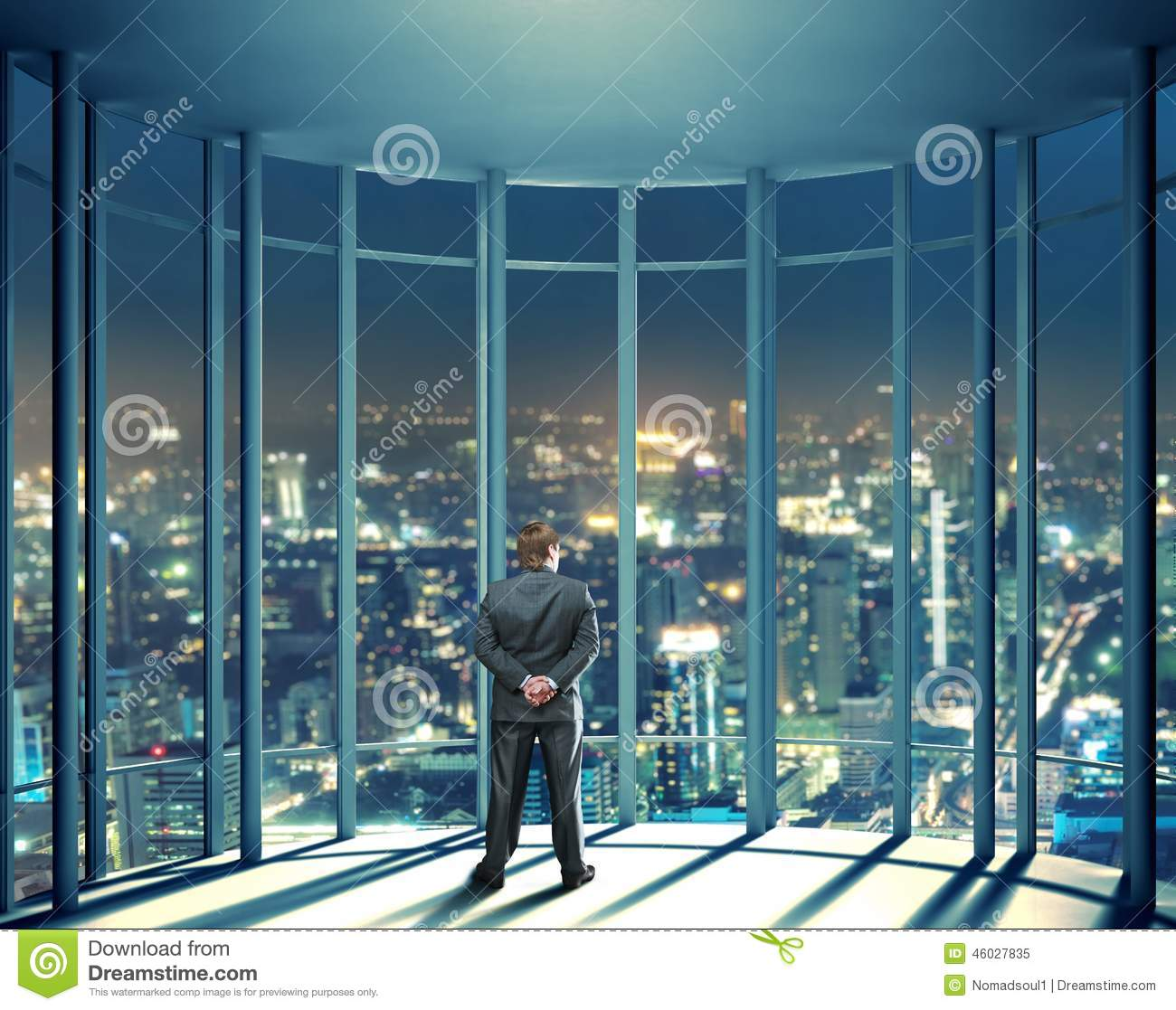 City Glass Windows : Night view of buildings and man from glass window stock