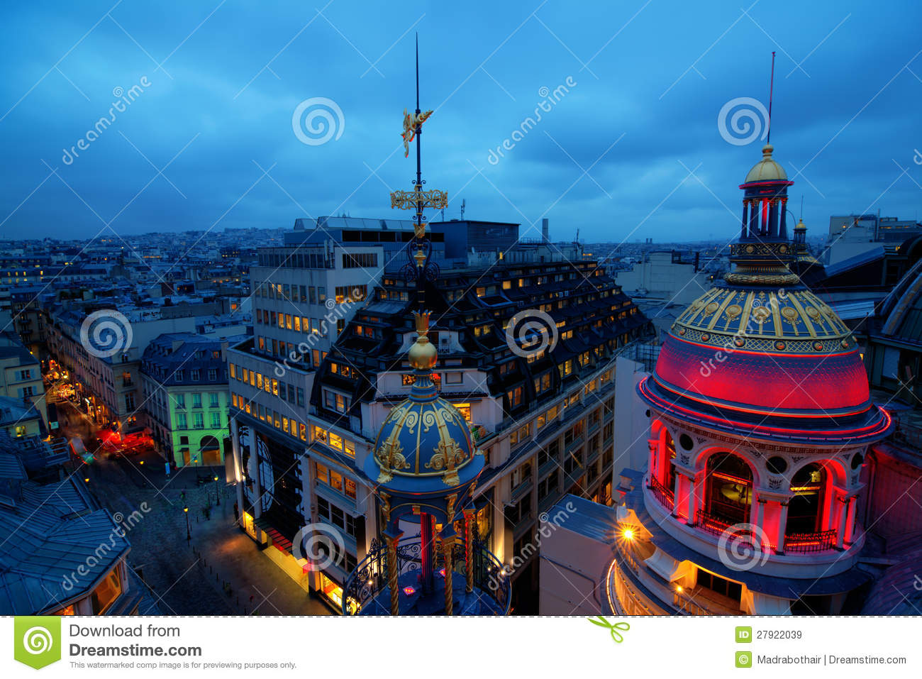 Night panorama view over the roofs of paris with an enlightened dome