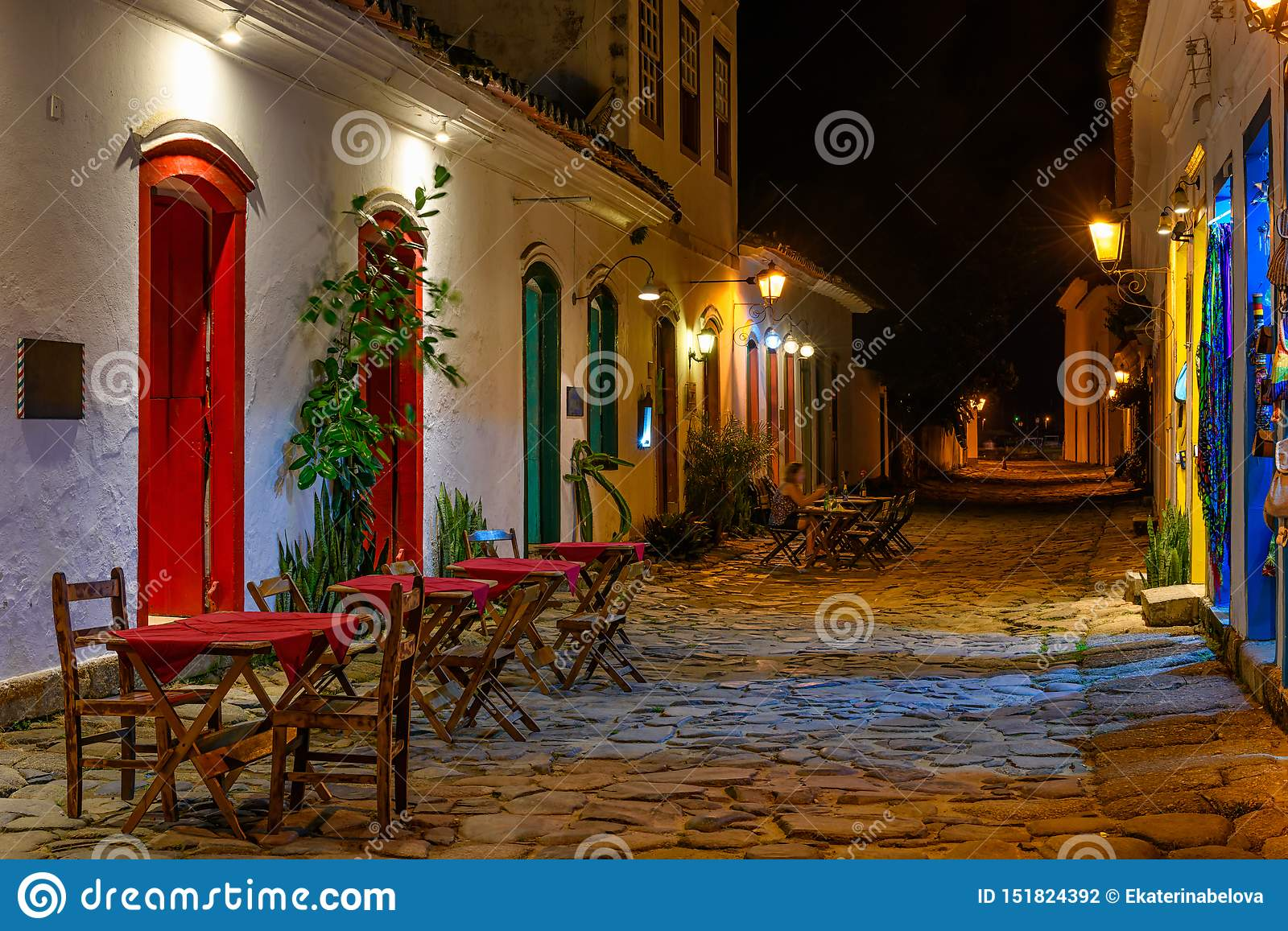 Night view of street of historical center with tables of restaurant in Paraty, Rio de Janeiro, Brazil.
