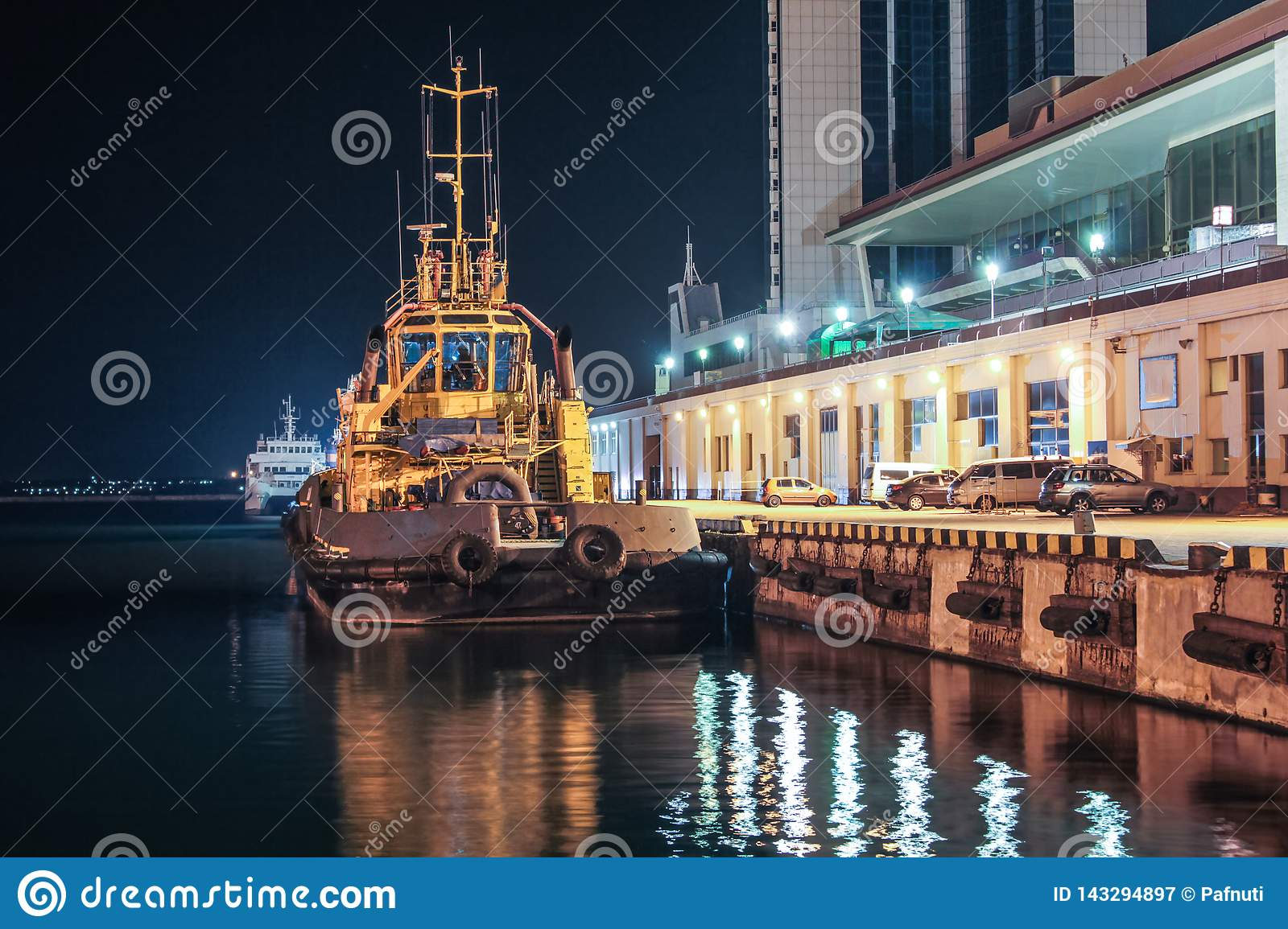 Night view of the tugboat in the cargo port