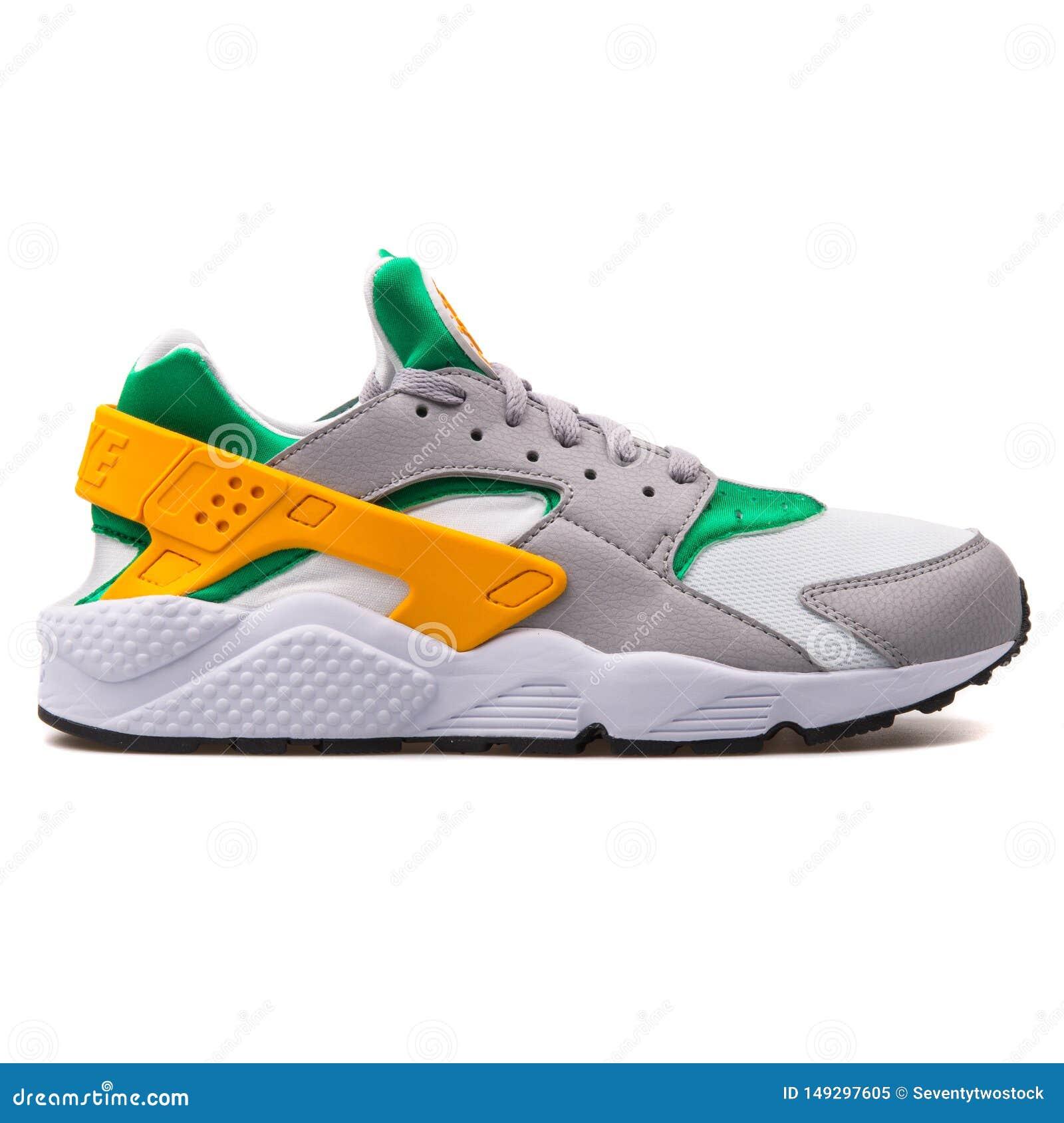 Nike Air Huarache Grey, Green, Yellow And White Sneaker Editorial ...