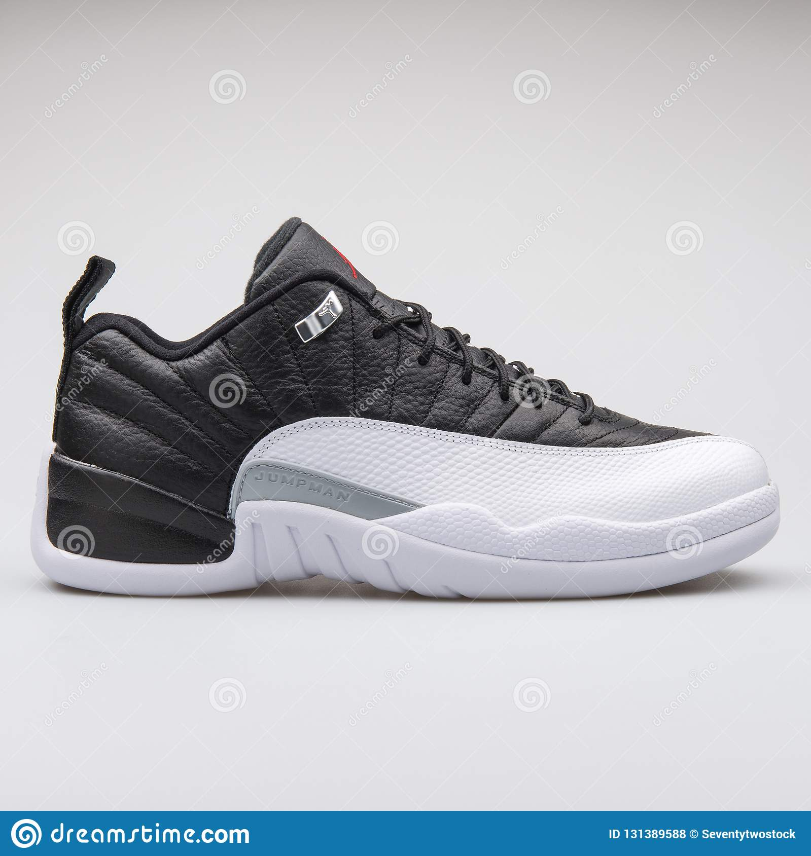 b1dca103 Nike Air Jordan 12 Low Retro black and white sneaker isolated on grey  background