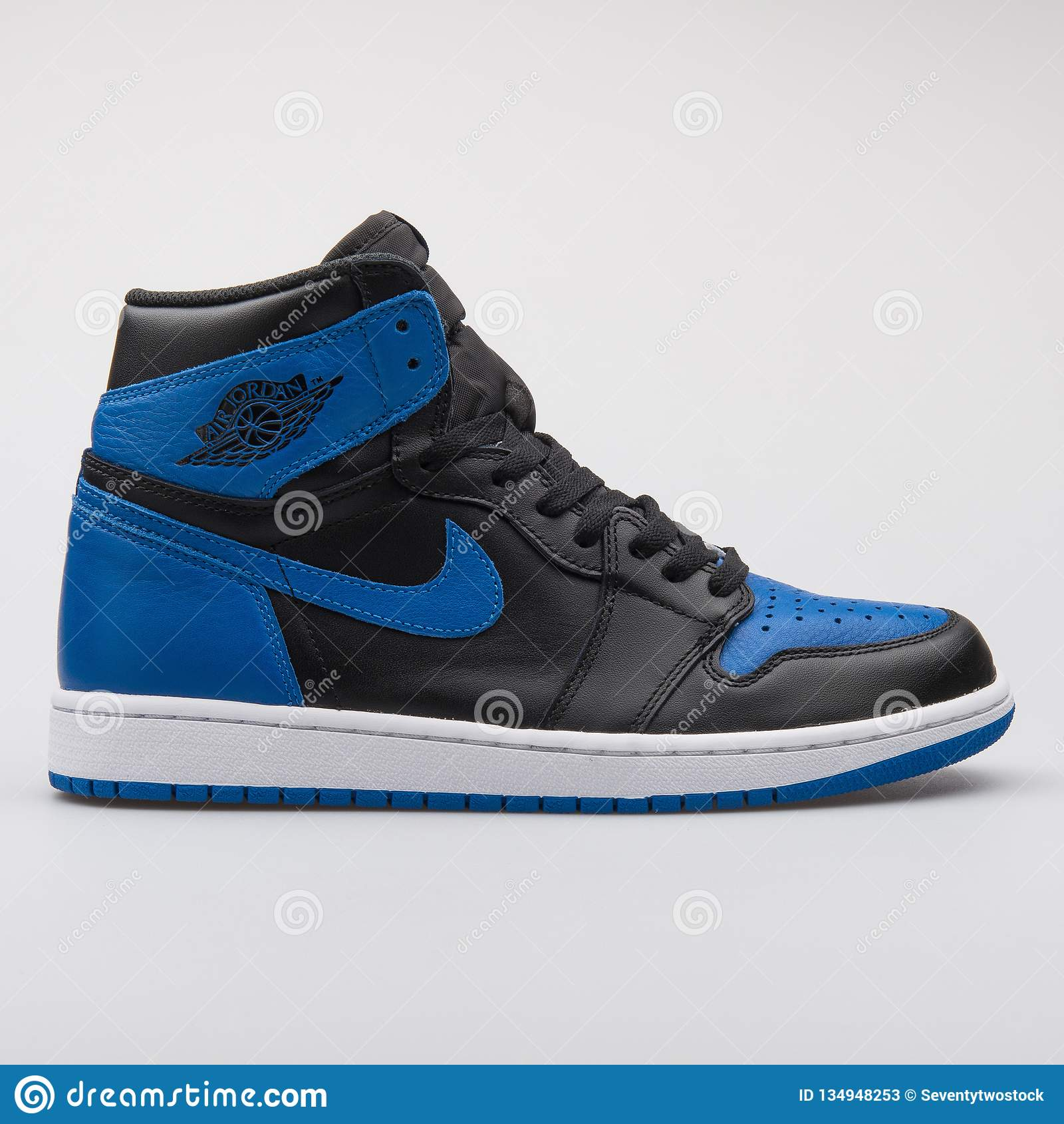 quality design d5f25 49712 VIENNA, AUSTRIA - JUNE 14, 2017  Nike Air Jordan 1 Retro High OG black and  blue sneaker isolated on grey background