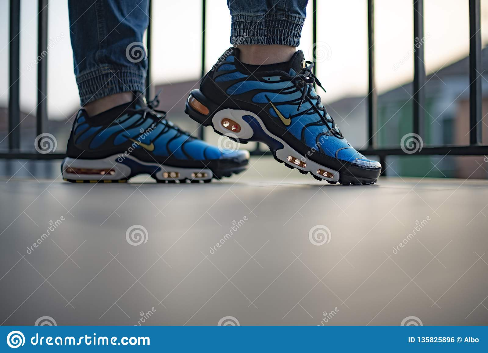 be0fdfd3 Milan, Italy - December 1, 2018: Young man wearing Nike Air Max Plus TN  Hyperblue shoes in the street - illustrative editorial. More similar stock  images