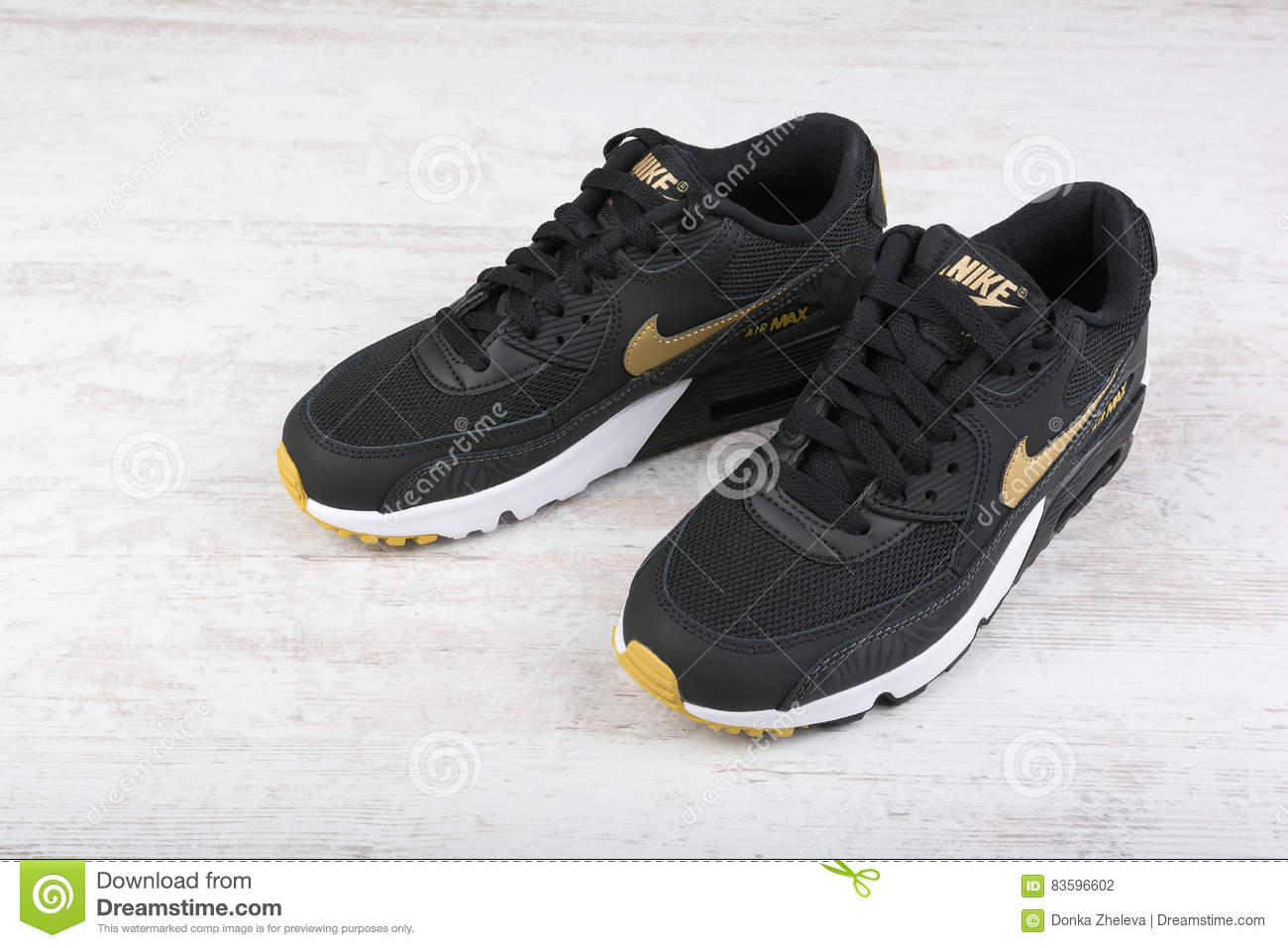 best website 9ffd9 fbe73 Nike Air MAX women`s shoes - sneakers in black, on white wooden background.