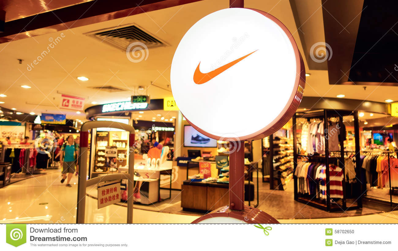 d6bb69f211f15 Nike fashion shop with logo and sign. Front of Nike sports retail store.