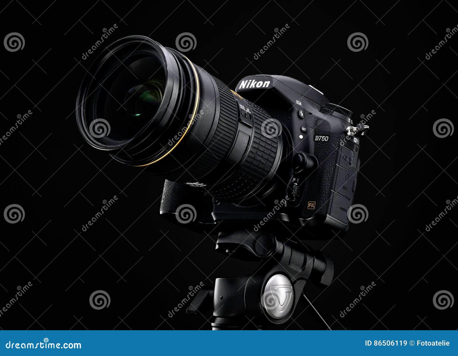 Nikon d750 and zoom lens over black background