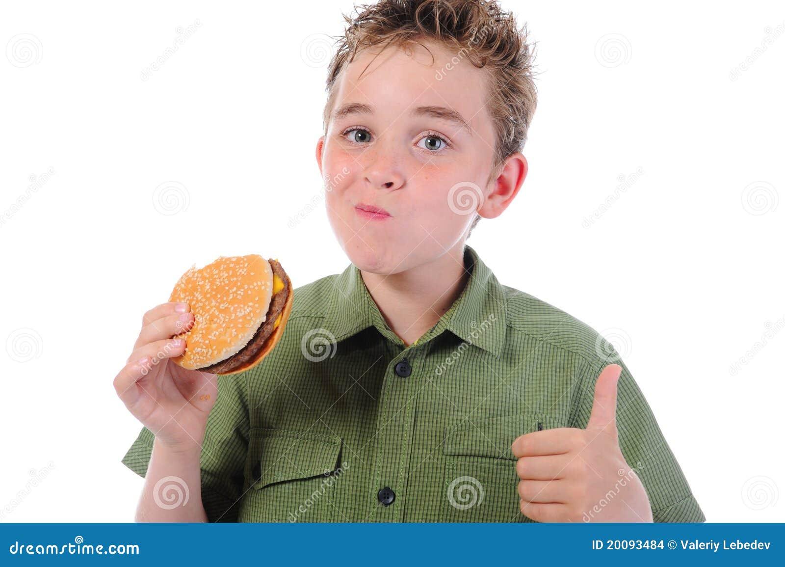 Ni o peque o que come una hamburguesa imagenes de archivo - Foto nino pequeno ...