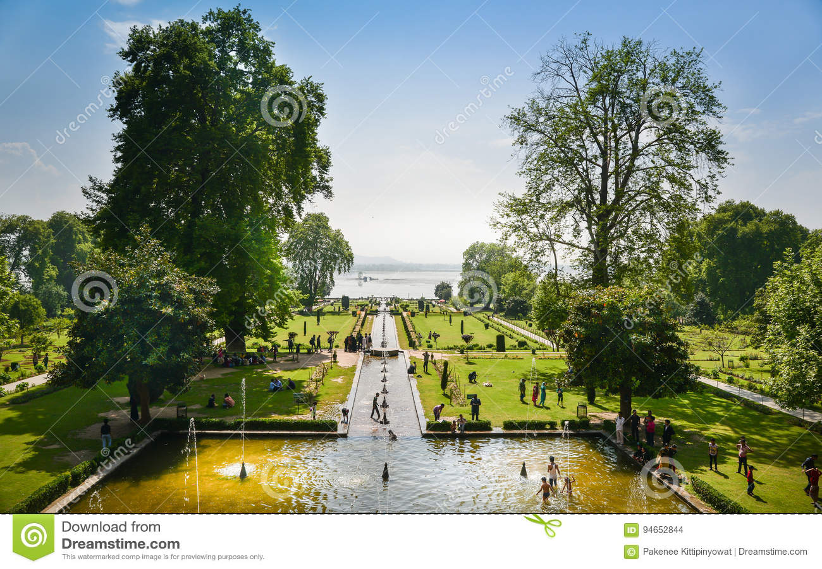 NISHAT BAGH, SRINAGAR, KASHMIR, INDIA-MAY, 2017: People enjoy summer in Nishat Bagh garden