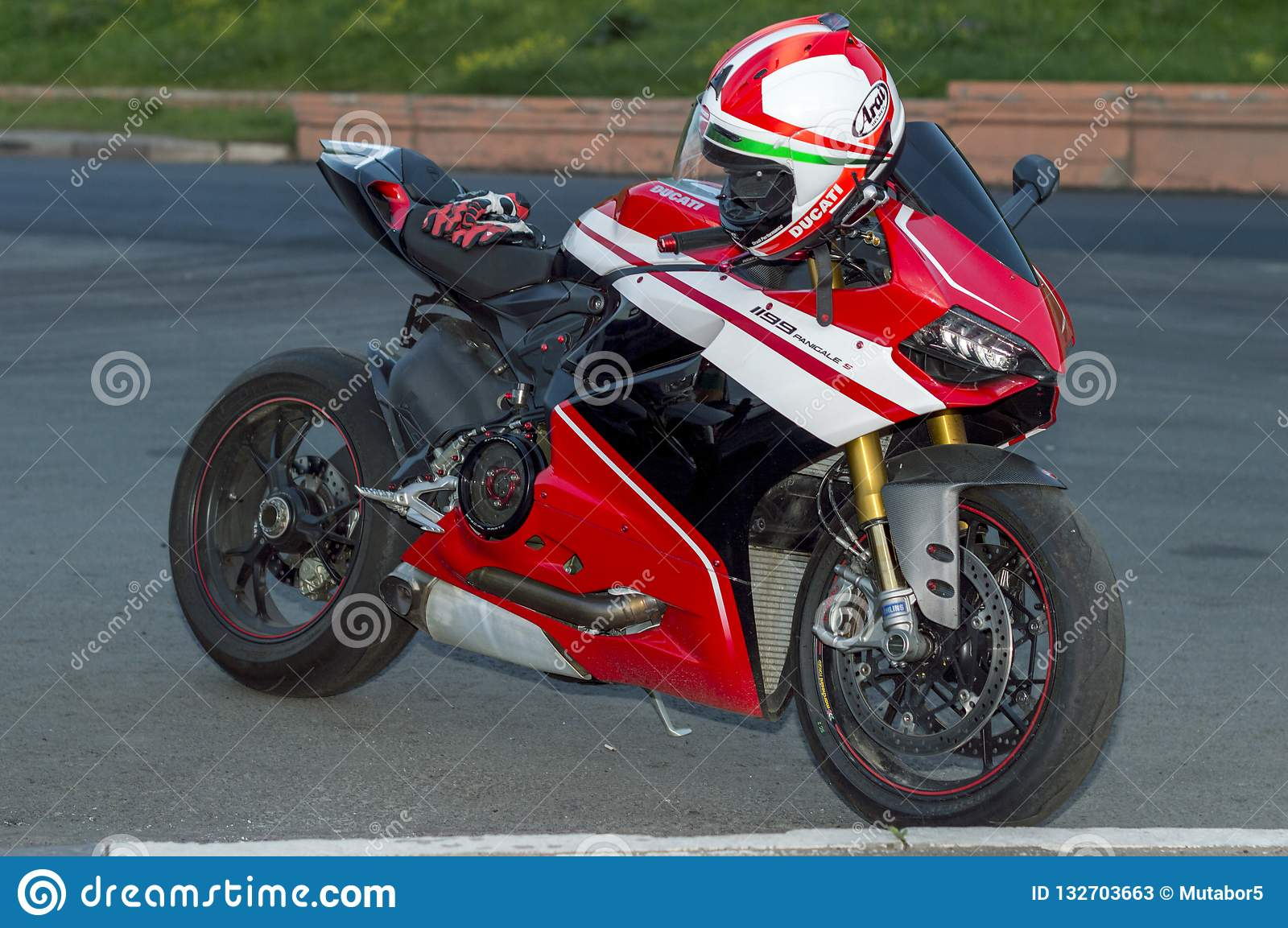 Model Motorcycle, Ducati. Left side, standing, red helmet and gloves on the seat. RUSSIA