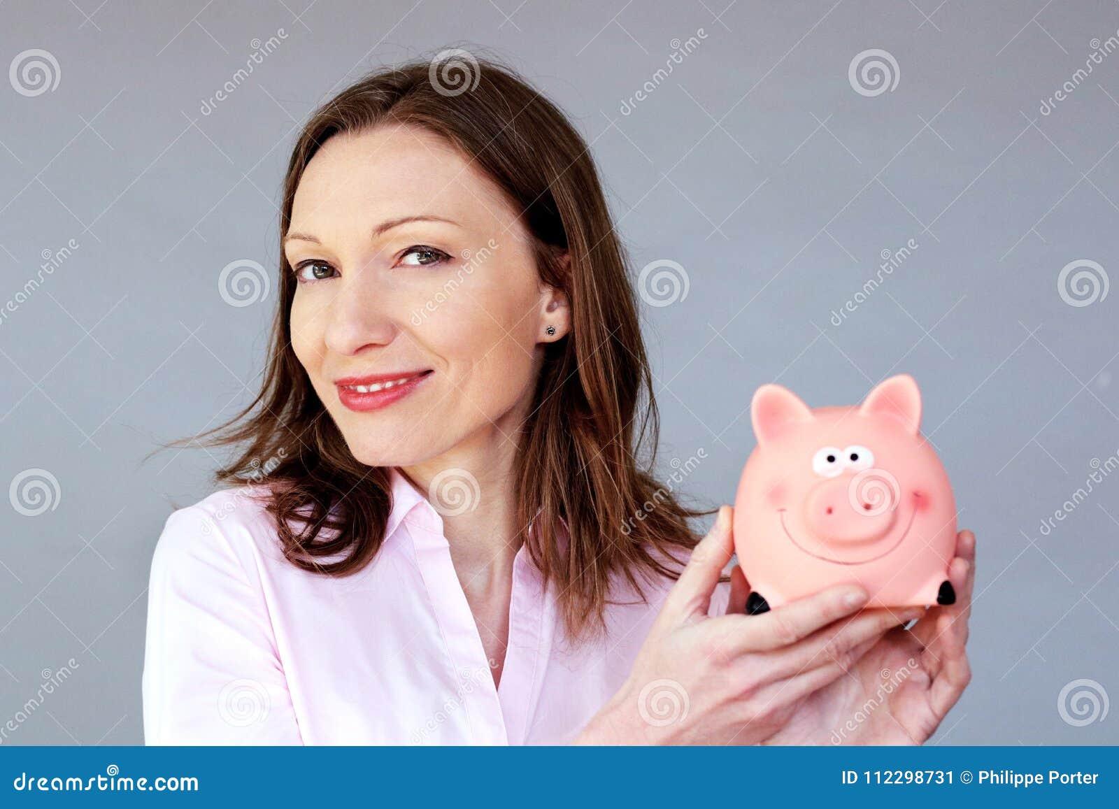 Money savings no stress woman holding moneybox piggy bank