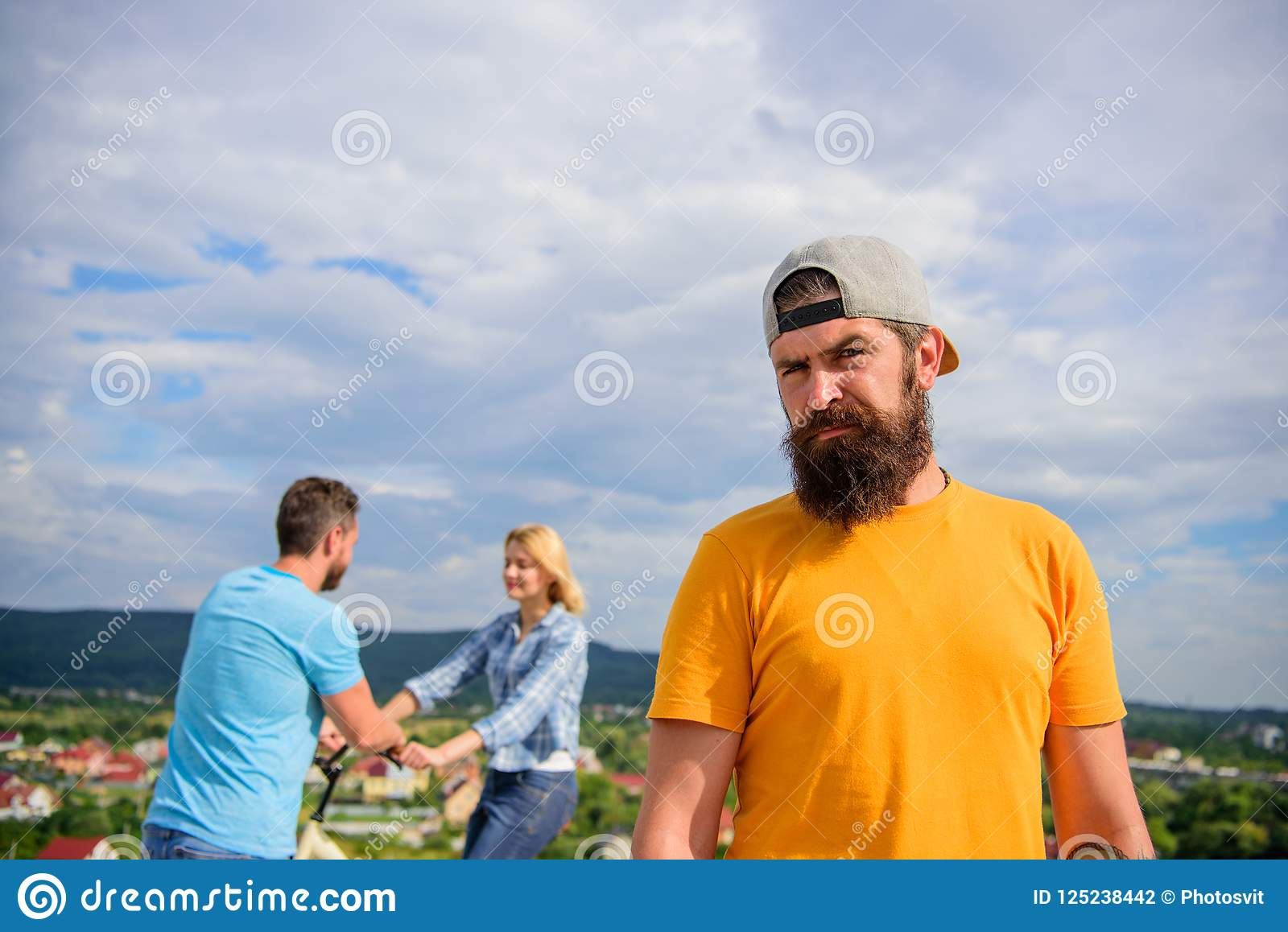 No romantic in his life. Guy adult still lonely while friends happy family life. Hipster sad face in front of couple in