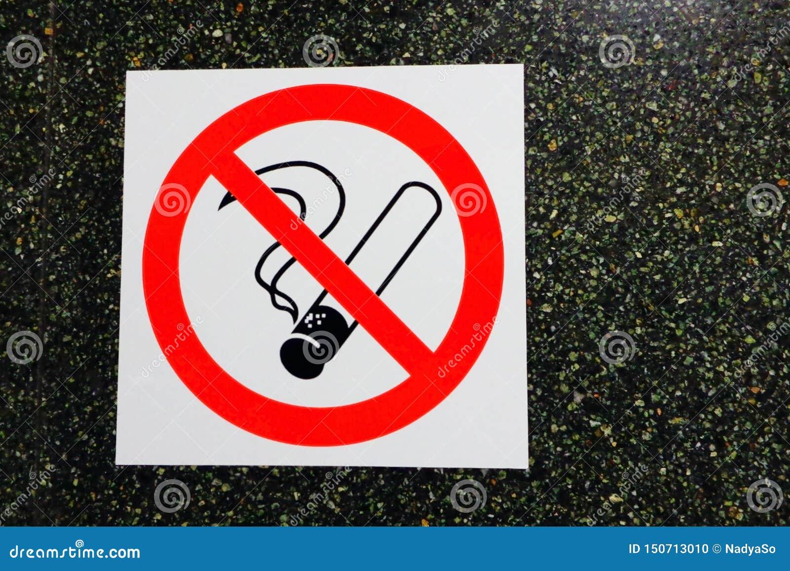 No smoking icon sticker on dark stone wall background