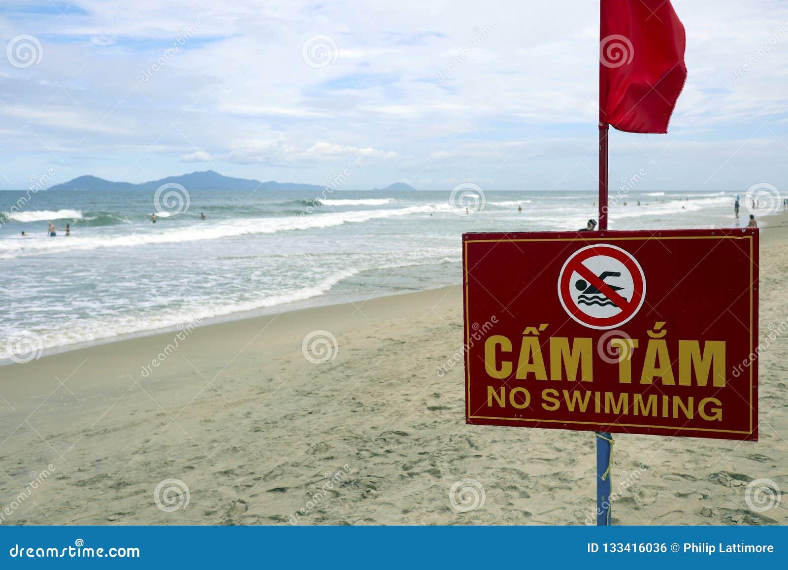 No swiiming sign on a beach in hoi an vietnam