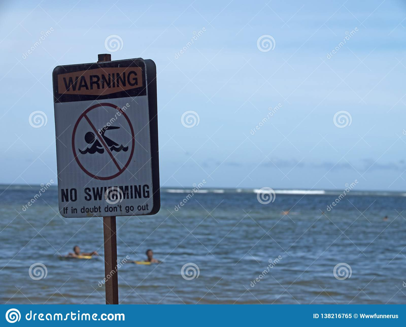 No Swimming Sign - Danger Concept - People in Water