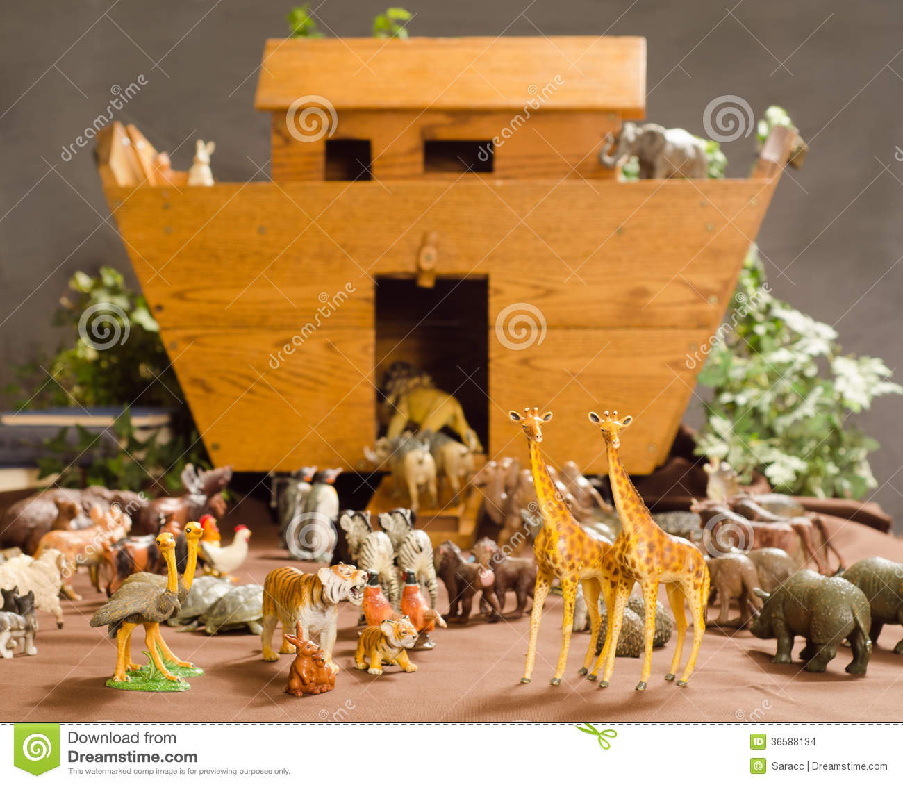 Toys animals surrounding a wooden toy chest made in the shape of Noah ...