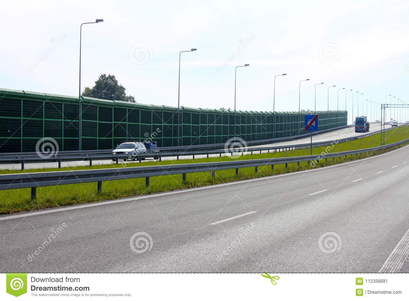 Noise barrier, acoustic screen, highway, cars on the sound-absorbing tunnel