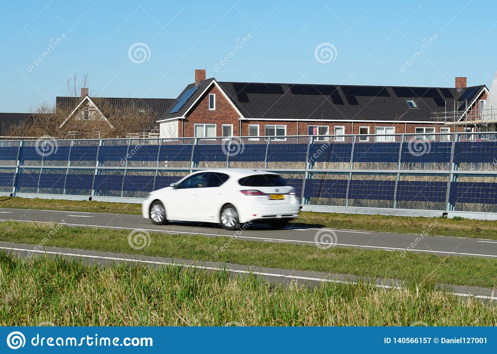 Noise barrier with integrated solar panels
